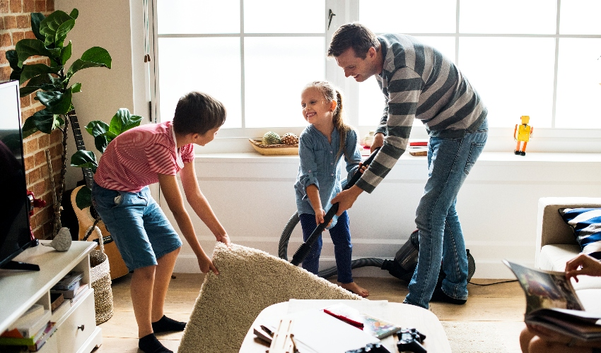 Family cleaning together to help control spring allergies at home.